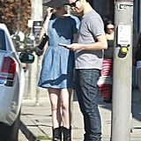 Anne Hathaway wore a denim dress and black sun hat while out with Adam Shulman in LA.