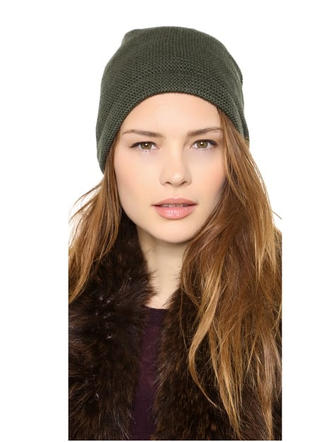 Get your cool-girl beanie on with this 1717 olive purl knit slouch beanie ($44).