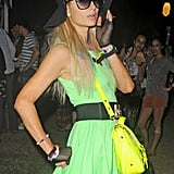 Paris Hilton donned a neon green dress and bag at Coachella's second weekend.