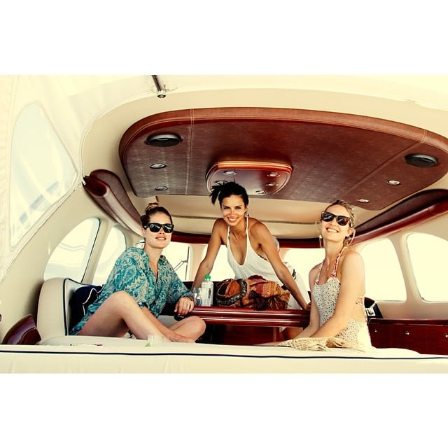 Doutzen Kroes relaxed on a boat with Adriana Lima and Candice Swanepoel. Source: Instagram user doutzen
