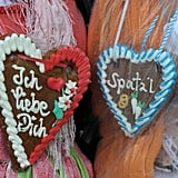 "Visitors of the Oktoberfest beer festival wear gingerbread hearts reading, ""I love you"" and ""Spatzl."""