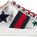 Stand out in these Gucci Metallic Star Trainers ($620).