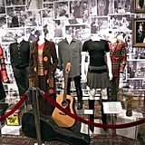 Some of the most iconic costumes from the show (including Phoebe's guitar!) are on display at Central Perk.