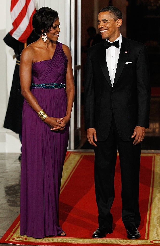 Michelle Obama stole the show in a deep purple gown by American designer Doo.Ri at a state dinner welcoming South Korea. The statement gold earrings, matching cuff, and turquoise beaded belt only added an extra dose of glam.