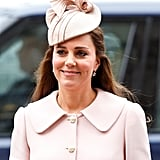 Kate accessorized her petal pink Alexander McQueen coat with a Jane Taylor hat at the Commonwealth Obervance Service in 2015.