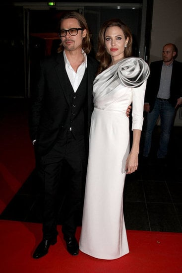 Angelina Jolie stepped out, wearing a bold gown for the Paris premiere of In the Land of Blood and Honey with Brad Pitt by her side in February.