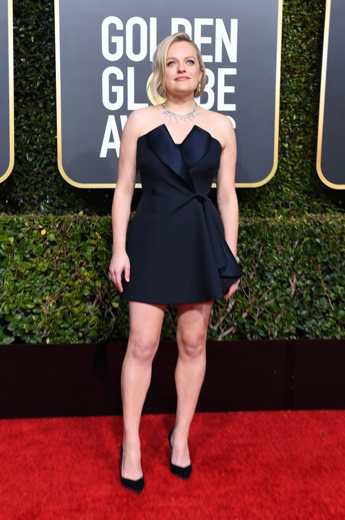 Elisabeth Moss wearing Dior Haute Couture minidress and Tamara Mellon heels.