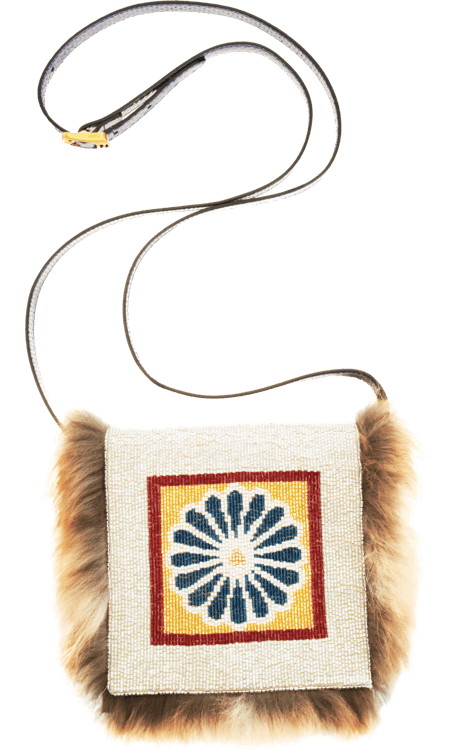 If I was the lucky recipient of this magnificent beaded Fendi Daisy clutch ($2,270), I would wear it with anything; jeans, dresses, gowns, — you name it. This is indeed a wish list right?