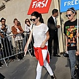 Cara and Kendall Jenner got political at Karl Lagerfeld's runway-turned-riot Spring '15 show.