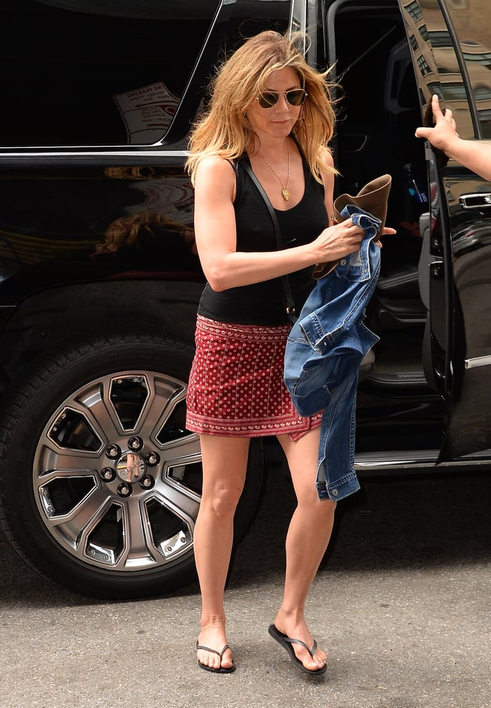Styling a red miniskirt with a black tank top in June 2016.