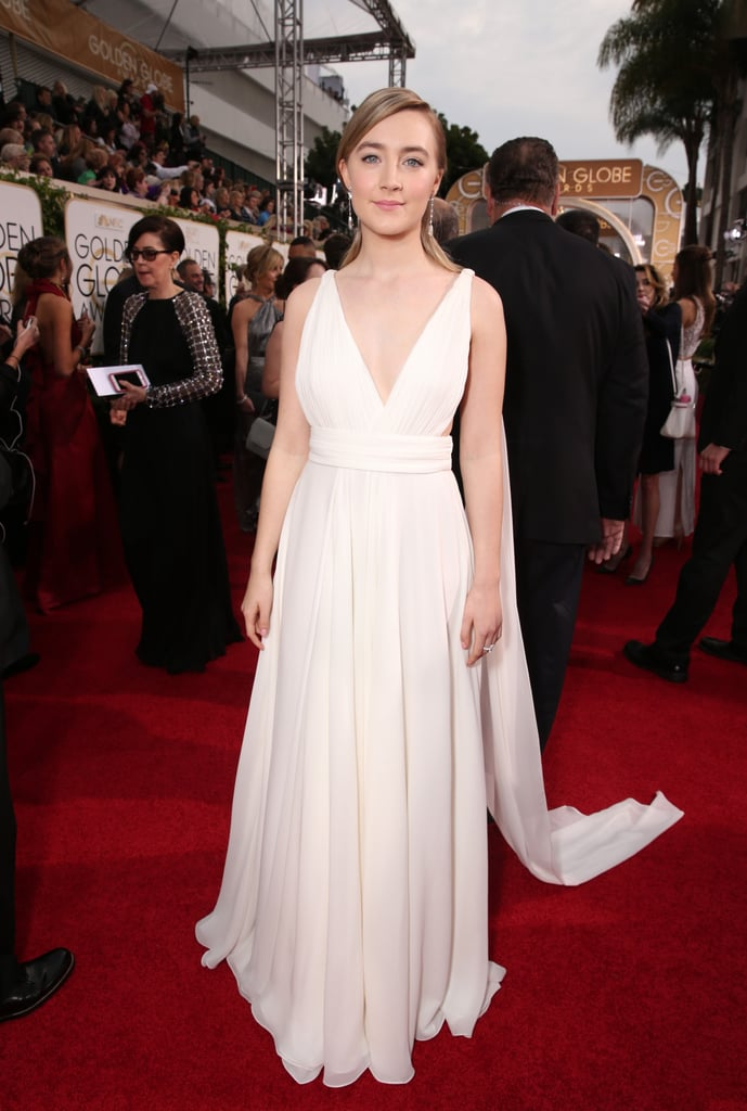Saoirse Ronan in an Yves Saint Laurent Couture by Hedi Slimane white gown