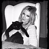 Delta Goodrem worked bed hair like no other as she snuggled up with her cat. Source: Instagram user deltagoodrem