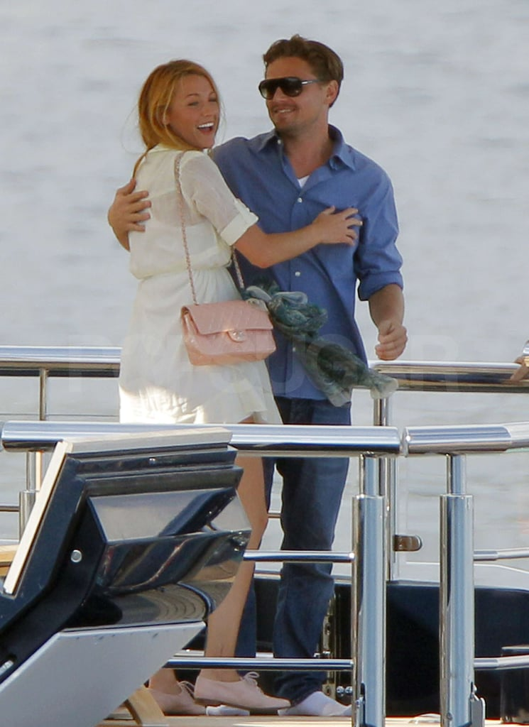 Leonardo DiCaprio and Blake Lively shared a hug and a few laughs on Steven Spielberg and Kate Capshaw's yacht in Cannes today. Blake kicked off her trip to France last week with a soirée for Karl Lagerfeld and also took in Chanel's resort collection runway show on the Riviera. Leo, for his part, has been hanging out with his buddies and colleagues at the film festival in the wake of his split with longtime girlfriend Bar Refaeli. The actor was spotted with Blake at the Hotel du Cap on Friday night, sparking buzz that Leo may be striking up a new romance with Blake post-breakup. The pair got close again today, but they were joined by a group of friends including Steven, Kate, and Lukas Haas while on the water.