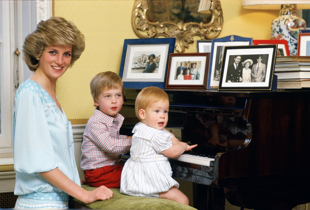 Diana, Princess of Wales, poses with Prince William and Prince Harry at the piano in Kensington Palace, where Diana resided from 1981 until her death in 1997.