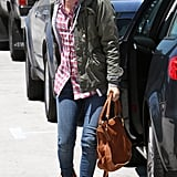 Rachel Bilson working some happening trends: army jacket, plaid shirt, and brown suede Chloe booties.