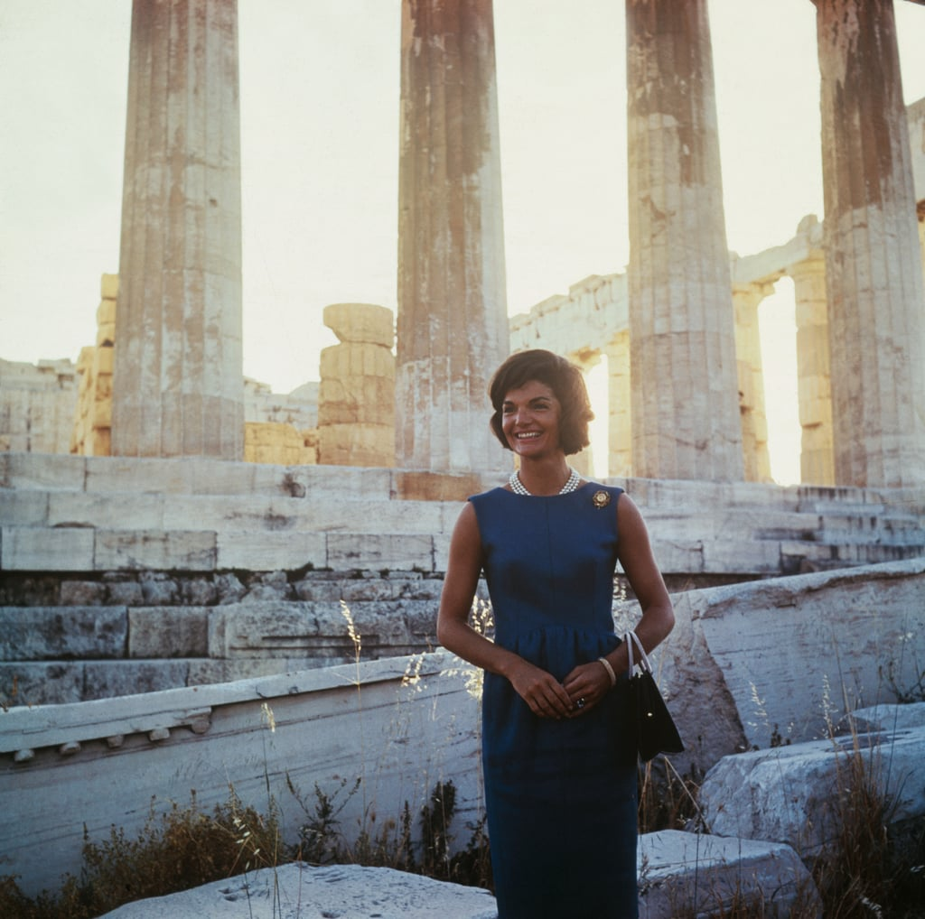 Jackie's stone looked gorgeous with a deep teal dress while touring the Acropolis in 1961.