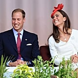 Kate Middleton flashes a huge smile her husband's way.