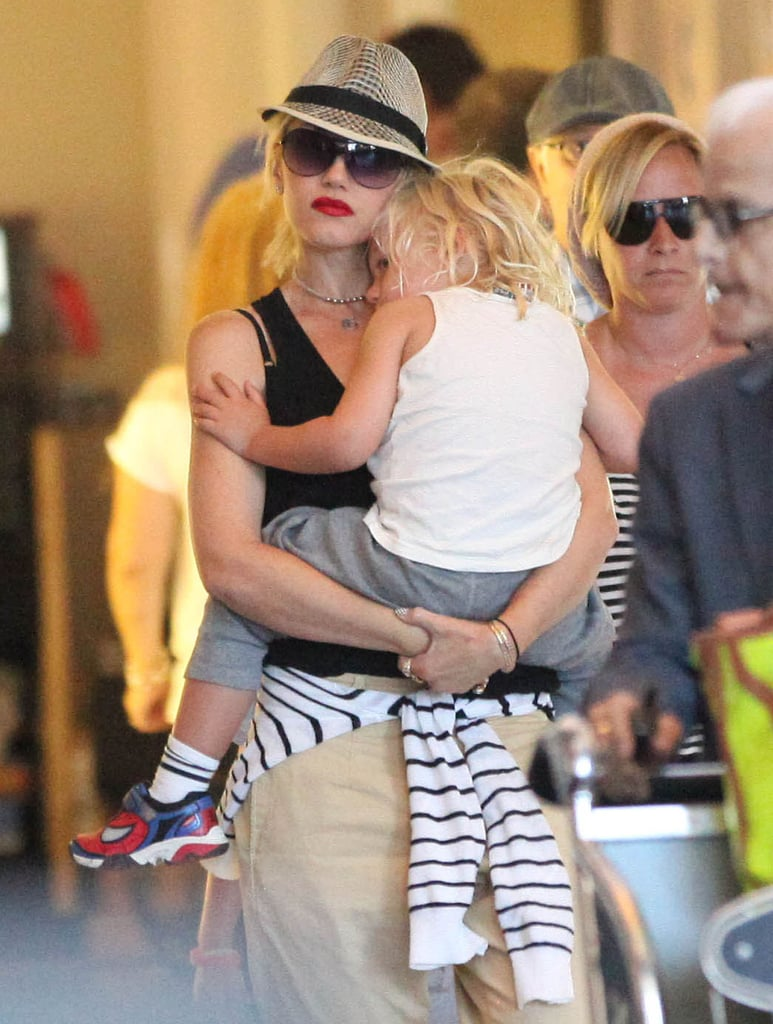 Gwen Stefani carried Zuma while he slept on her shoulder at LAX.