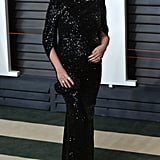 Chrissy's afterparty outfit for the Vanity Fair bash was all about the glitz and glam. She chose a Talbot Runhof gown that featured an off-the-shoulder neckline and three-quarter sleeves. Chrissy finished her look with a Giuseppe Zanotti clutch.
