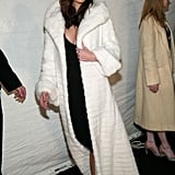 In 2002, Melania wore this lavish, long white coat over a cleavage-baring black dress to the Victoria's Secret Fashion Show in New York.