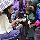 Kate met a young child during an archery demonstration on the couple's trip to Bhutan in April 2016.