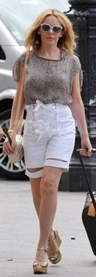 8d89f3c9f50 Kylie Minogue Wearing White YSL Shorts and Jimmy Choo Wedges ...