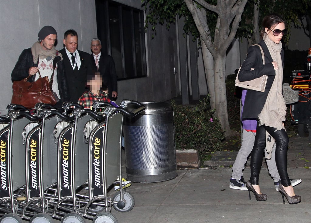The Beckhams were spotted at LAX on Monday after a flight from London — they spent their Christmas in the UK with family, and were wrapped up warm for their return to California. Victoria wore sky-high heels and a big scarf with her leather leggings, while David wore a hat and scarf to help carry their bags from the airport to the car with Romeo. While they've been enjoying some family time, Victoria's first own design handbag hit net-a-porter.com last week and nearly sold out within an hour!