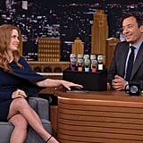 Amy Wore a Navy Cape Dress During Her Appearance on The Tonight Show Starring Jimmy Fallon