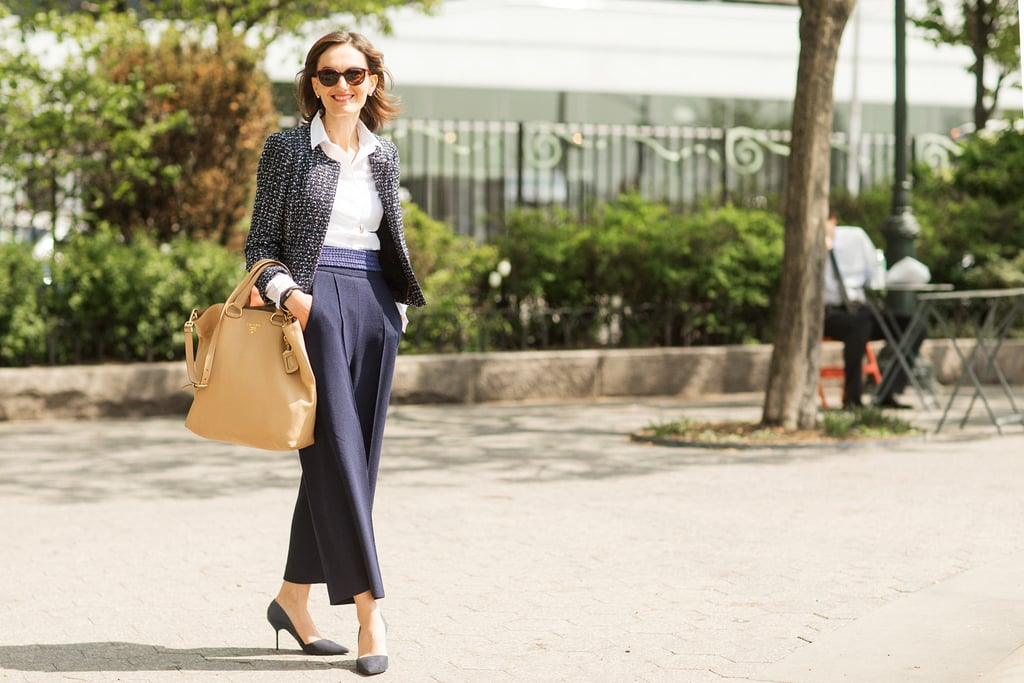 Light wide-legged trousers paired with an always-chic white button down are an office-ready combination you can wear over and over again.