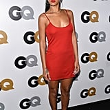 Spotted at the GQ Men of the Year party, Rihanna showed off her curves in a simple yet sexy strappy red dress by Calvin Klein, paired with Manolo Blahnik sandals, hoop earrings, and a bold red lip.