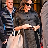 The glossy finish sunglasses feature a gold trim across the top and are far more affordable than most of Meghan's designer styles.