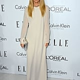 Rachel Zoe selected a creamy, sheer-sleeved maxi dress, bold chain-link jewels, and a silver metallic clutch to further the glamour.