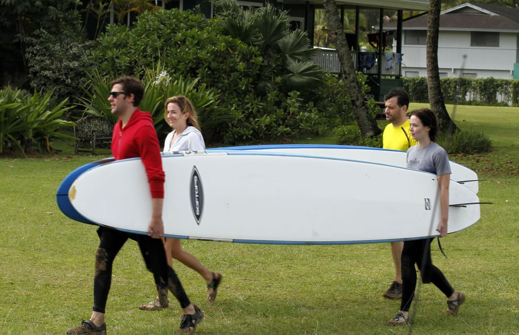 John Krasinski, Emily Blunt, Jimmy Kimmel, and Molly McNearney hit the beach to surf.