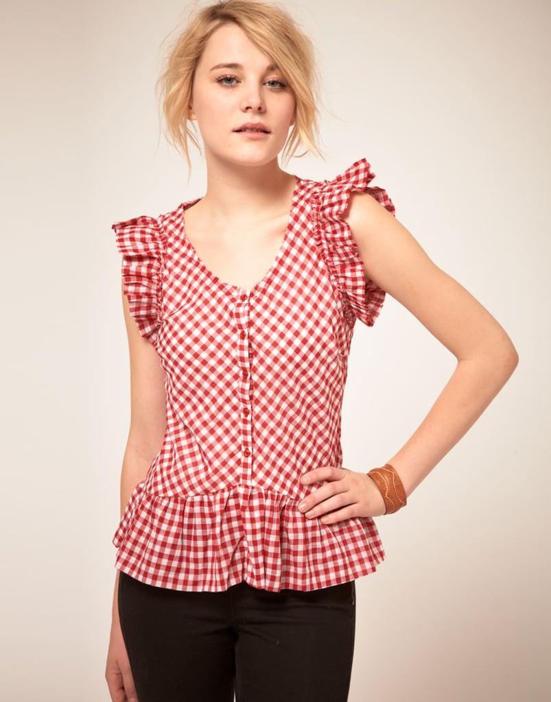 This red gingham blouse gets an even girlie finish with ruffle trim – just the thing to add some flair to a pair of black skinnies.  By Zoe Gingham Short Sleeved Shirt ($106)