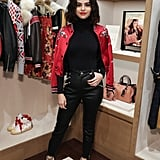 While in NYC, the star made time to stop by the Coach store for an appearance promoting her collab with the label. Selena wore a monogrammed bomber jacket with her all-black outfit.