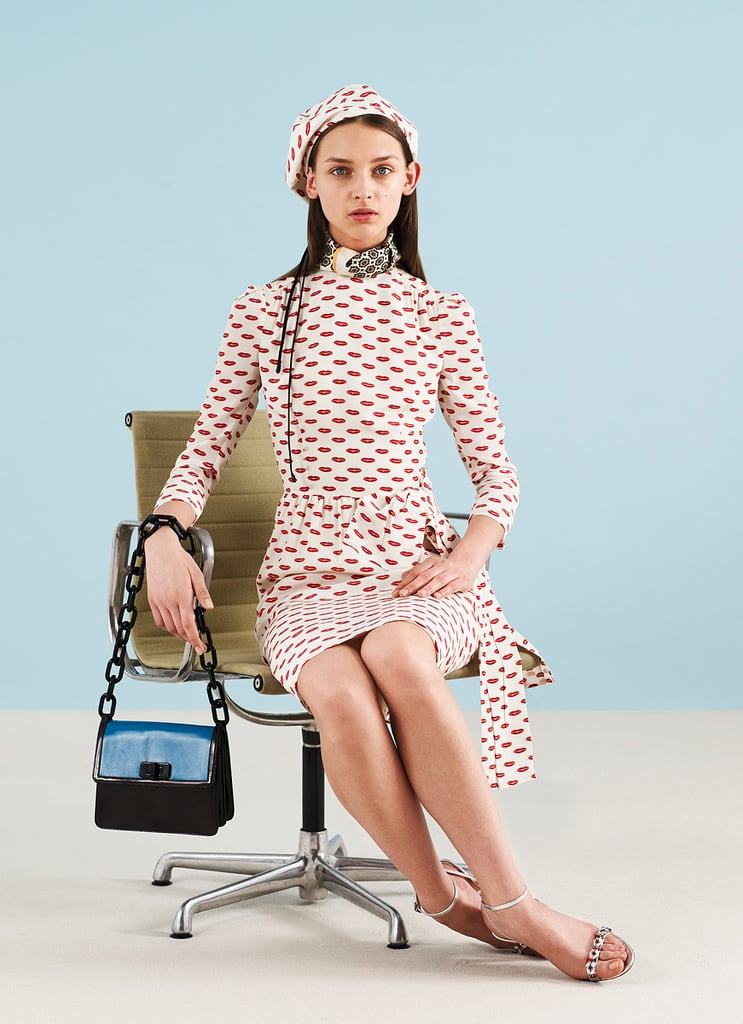 >> Fans of the Prada lip print, rejoice — it's back in mini form on skirts, dresses, tops, and bags for Miuccia Prada's Resort 2012 collection. But it's not the only print in the collection by a long shot — grids, '60s floral brights, dots, and even lace fill out the offering. Prada accessorized each look with a printed foulard and/or beret, and lady-like pumps, mules, or sandals — no chunky platforms in sight.
