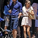 Olivia Palermo and her guy, Johannes Huebl, made one seriously good-looking duo while out in NYC — Olivia was outfitted for the heat in an easy day dress and coordinating accessories; Johannes played to his sporty side.