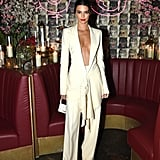 For a night out at the Business of Fashion issue launch event in May, Kendall wore a plunging ivory suit that was loosely clasped at the waist. She accessorized her daring outfit with a mini white Jacquemus bag and orange Dorateymur Groupie mules which glowed in the dark when she hit the streets.