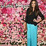 Chrissy Teigen stepped out in a pair of aqua-hued wide-leg pants and a semisheer blouse.