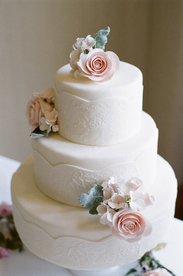 The details on this classic wedding cake are both soft and intricate at the same time — the embroidery-like pattern and florals are almost too sweet to eat.  Photo by Austin Warnock via Style Me Pretty