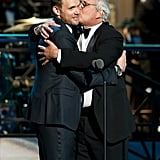 Joel McHale received a kiss from Chevy Chase at the Comedy Awards in NYC.