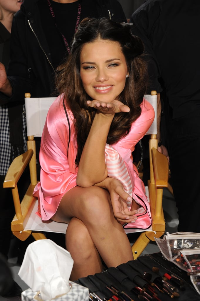 Adriana Lima blew the camera a kiss backstage.