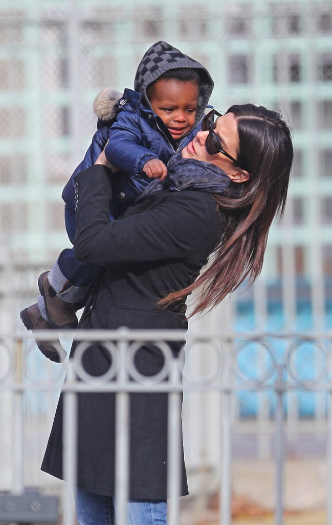 Sandra Bullock with Louis at a playground.