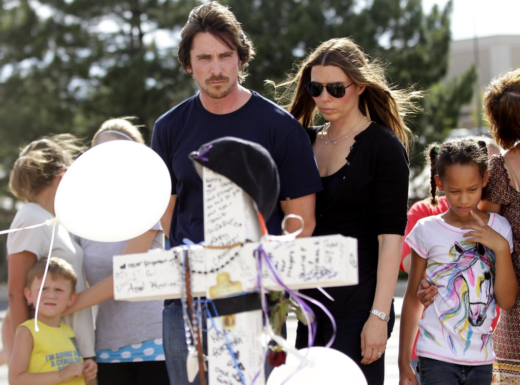 "Christian Bale and his wife, Sibi Blazic, brought flowers to contribute to the memorial outside the scene of the Dark Knight Rises massacre at the Century 16 theater in Aurora, CO, today. Earlier in the day, Christian also made a stop by the hospital to visit the victims of the shooting. One of the patients who was hurt during the attack, Carey Rottman, posted a photo of himself with Bale in his hospital room on his Facebook wall. Christian reportedly made the trip to Colorado on his own, not as a representative of the Warner Bros. movie studio or film. On Friday, Christian released a statement after the Dark Knight Rises shooting, saying, ""Words cannot express the horror that I feel. I cannot begin to truly understand the pain and grief of the victims and their loved ones, but my heart goes out to them."""