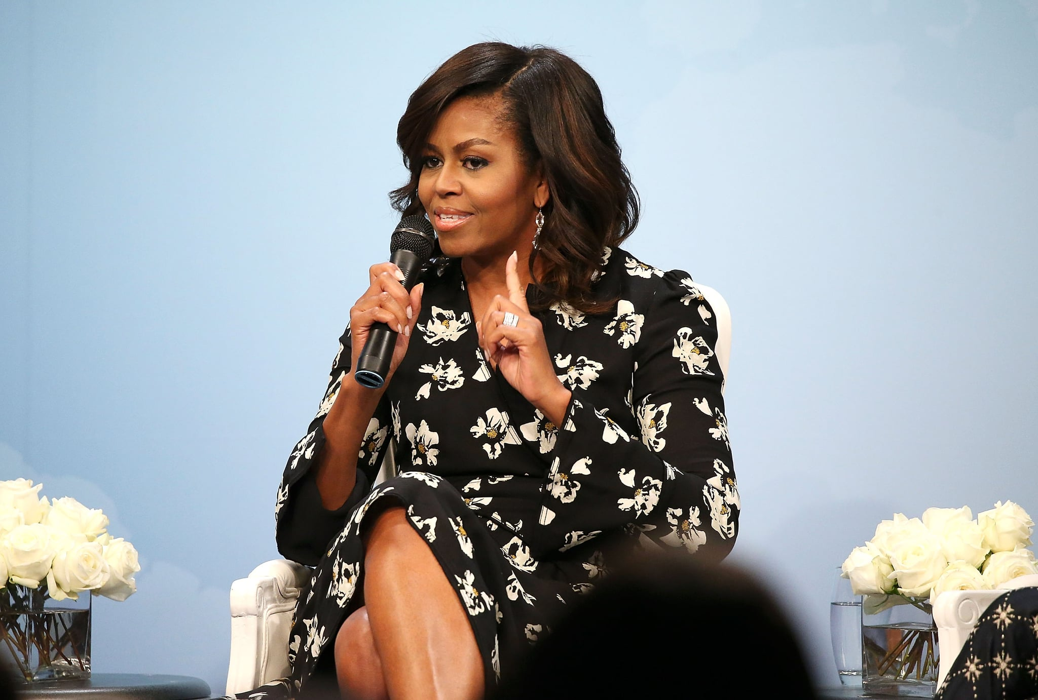 WASHINGTON, DC - OCTOBER 11:  First Lady of the United States Michelle Obama speaks during a panel discussion at Glamour Hosts