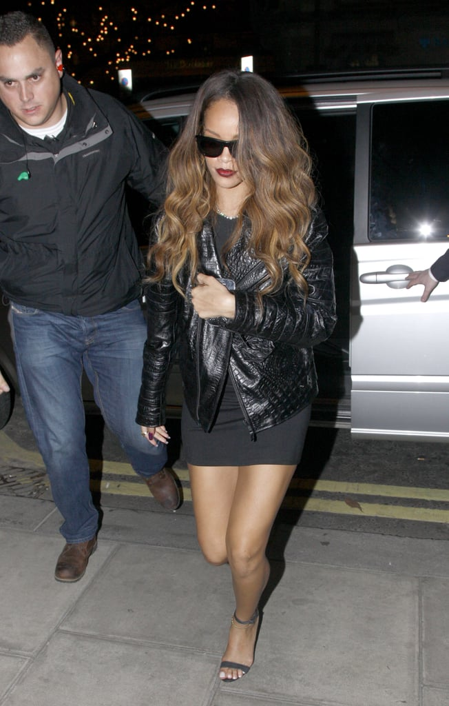 Rihanna headed to the afterparty for her River Island collection launch looking slick in a little black dress, a crocodile leather jacket, and blackout shades.