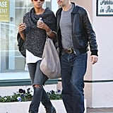 Halle Berry styled her ripped jeans, peppered sweater, and Monika Chiang hobo with Chloé's black studded ankle boots in Santa Monica.