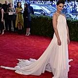 Katie Holmes was ethereal in a white chiffon Calvin Klein Collection halter gown and Lorraine Schwartz jewels.