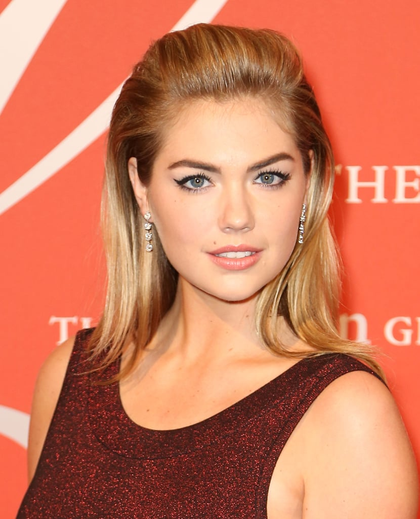 d4ac340b14e Kate Upton continues to embrace the blonde bombshell style with her winged  eyeliner and beauty mark