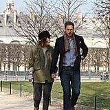 Drew Barrymore holds hands with fiancé Will Kopelman in the Tuileries.